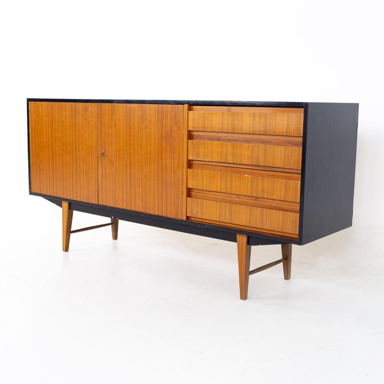 Mid century teak ebonized credenza Credenza measures: 65 wide x 17.75 deep x 31.5 inches high  All pieces of furniture can be had in what we call restored vintage condition. That means the piece is restored upon purchase so it's free of
