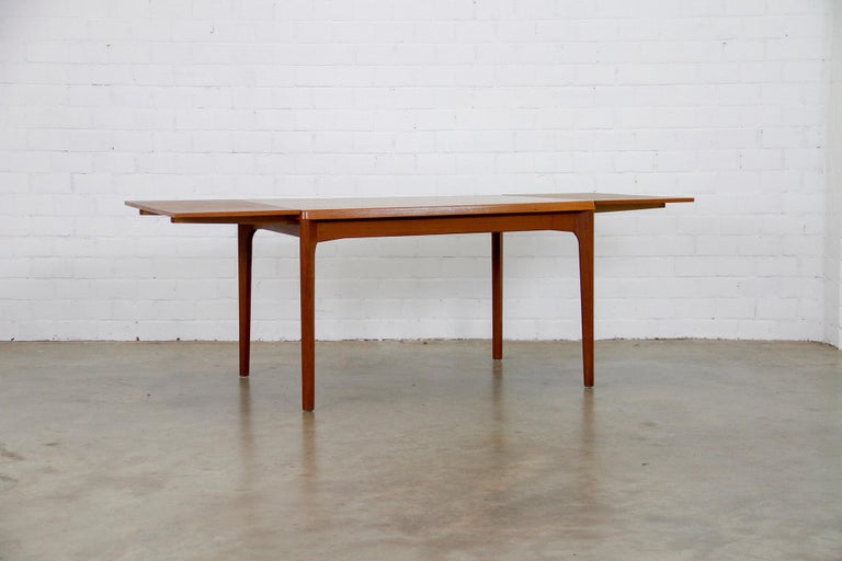 Vintage Danish extendable dining table designed in the 1960s by Henning Kjærnulf for Vejle Stole Møbelfabrik. The table is in very good condition and marked.