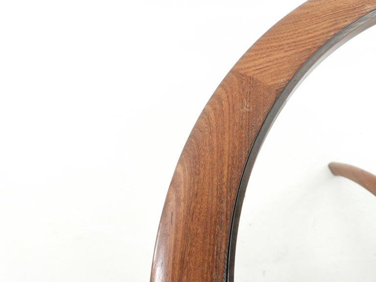 Rare G Plan teak and afromosia Astro/Spider coffee table, with clear glass insert.  Designed by Victor Wilkins for G Plan.  The Astro/Spider was originally described as an occasional table. Fewer of these coffee tables were produced, hence they