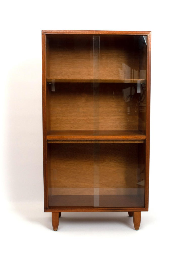 Midcentury teak glazed cabinet by Robert Heritage as part of the multi-width range for Beaver & Tapley. England, circa 1960. Glass siding doors, with one static and one adjustable shelf.  In very good vintage condition commensurate of age. Very