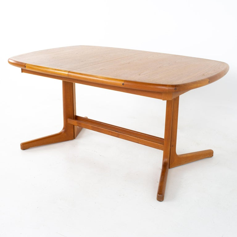 Mid century teak oval expanding dining table Table measures: 58.75 wide x 38.25 deep x 28.25 inches high; each leaf is 19 inches wide, making a maximum table width of 96.75 inches when both leaves are used  All pieces of furniture can be had in