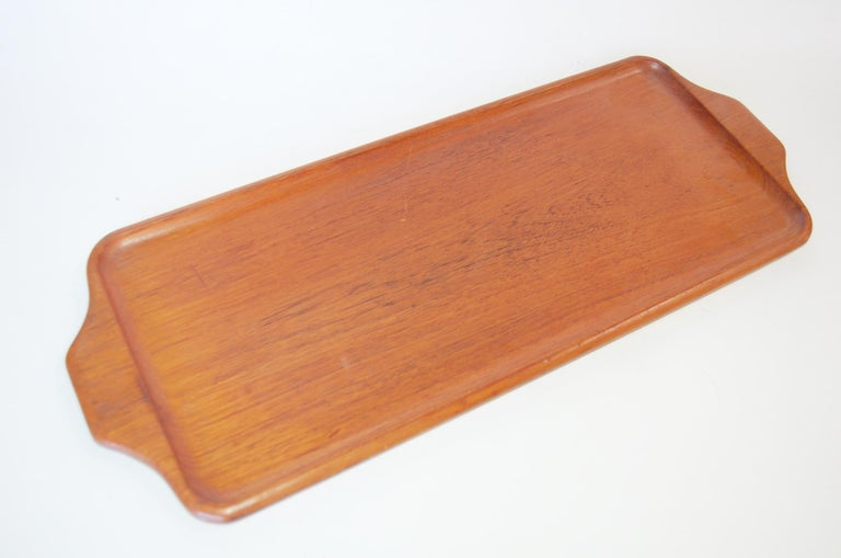 Midcentury rectangular Akta teak serving tray designed by Karl Holmberg AB, made in Götene   Stamped 170/4.   Measures: 21 3/4