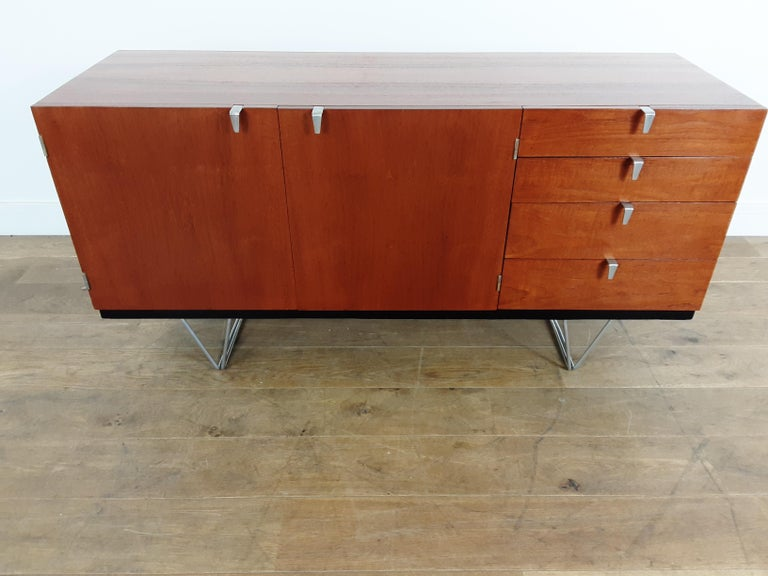 Mid-Century Modern design sideboard credenza beautiful teak wood sideboard with contrasting beech interior and polished steel handles, raised on polished tubular legs. Stag Furniture badge attached. Designed by John and Sylvia Reid s range