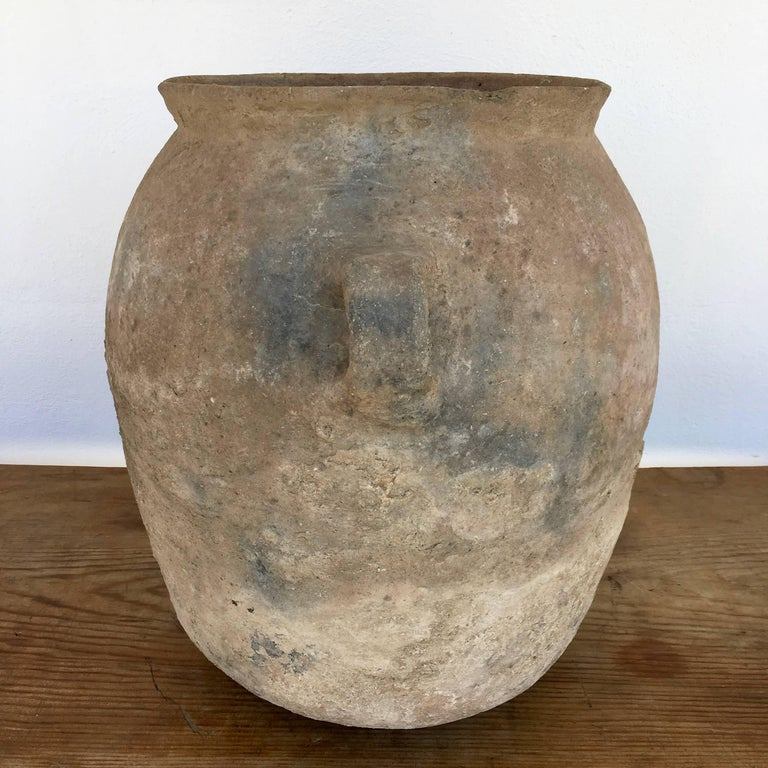 Mid-century terracotta or clay water vessel with nicely worn patina from Los Reyes Metzontla, Puebla. The design is a slight variation of the typical pottery found in this area. The pot's weight, age and style offer testimony to the age of this