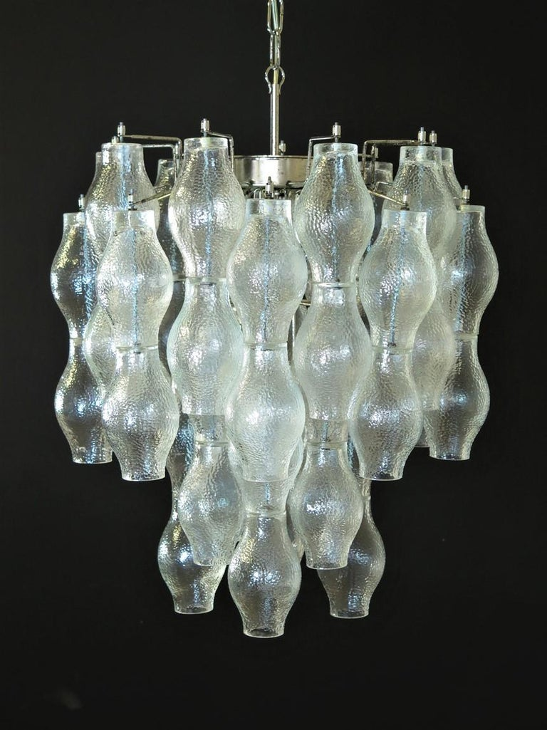 Italian vintage chandelier in Murano glass and metal. The lamp has 52 unobtainable poliedri trasparent glasses. Period: 1960s-1970s Dimensions: 49.21 inches (125 cm) height with chain; 23.60 inches (60 cm) height without chain; 19.65 inches (50