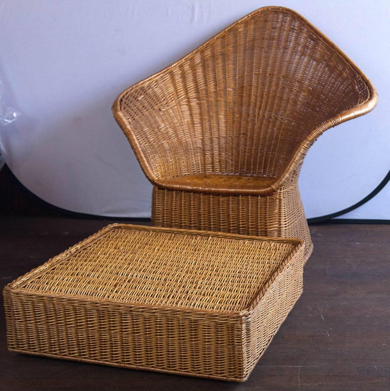 High drama! Unusual modern wicker armchair with large ottoman. Comfortable!