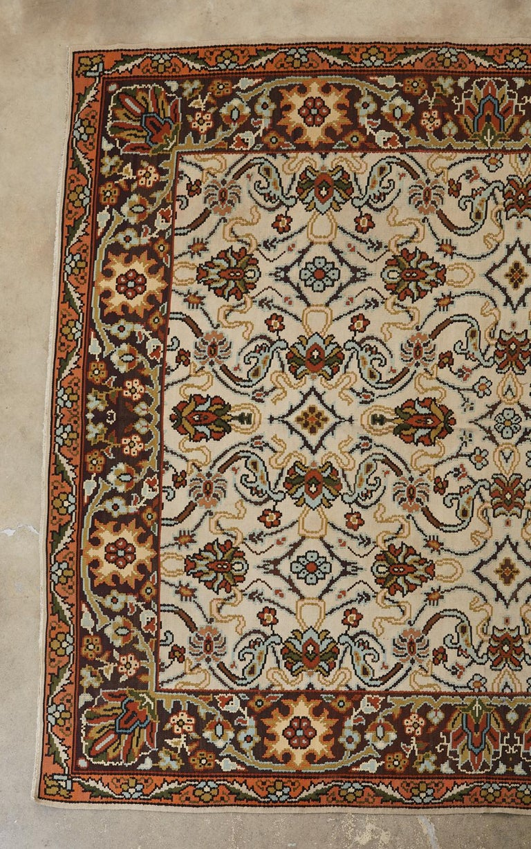 Large Mid-Century Modern Turkish flat-weave Thracian Kilim featuring an arts and crafts style floral decoration. The richly colored stylized flowers stand out prominent by against the khaki field. Beautifully woven with pale blue and green accents.