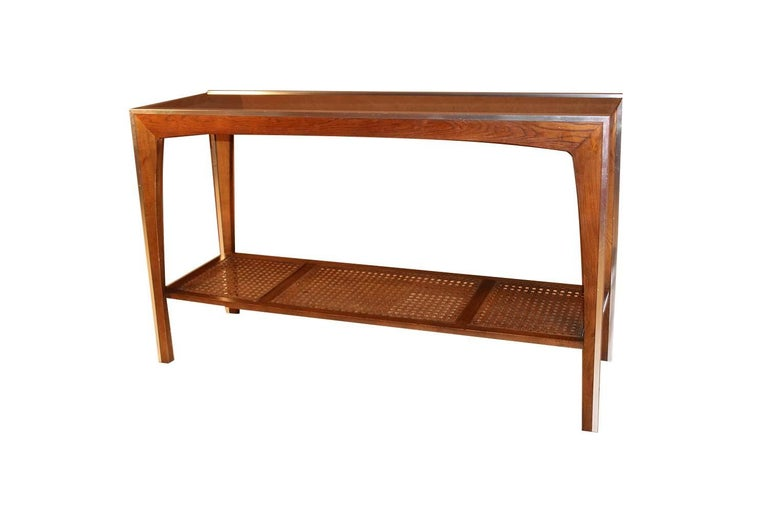 A walnut Mid-Century Modern two-tier console table in the style of Severin Hansen. Features a mirrored chrome framework with gorgeous warm walnut grain detail, fitted with a dark, smoked glass top, very Minimalist, modern aesthetic, a sleek