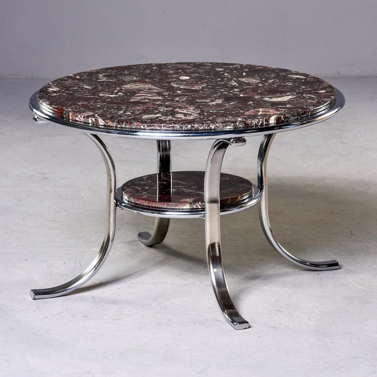 """Found in England, this circa 1970s cocktail table has a polished nickel frame and two round tiers of deep wine, cream and black colored marble inserts. Unknown maker.   Measures: Bottom shelf 13.75"""" x 9.5""""."""