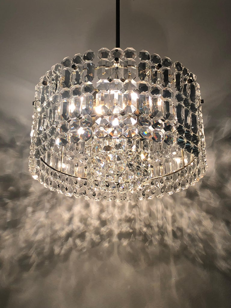 Wonderful Mid-Century Modern, high quality seven -light crystal chandelier by Kinkeldey, Germany, circa 1960s. This chandelier is made of  geometric crystal plates and brass frame. Socket: 6 x E14 and 1 x E27 (Edison) for standard screw bulbs. In