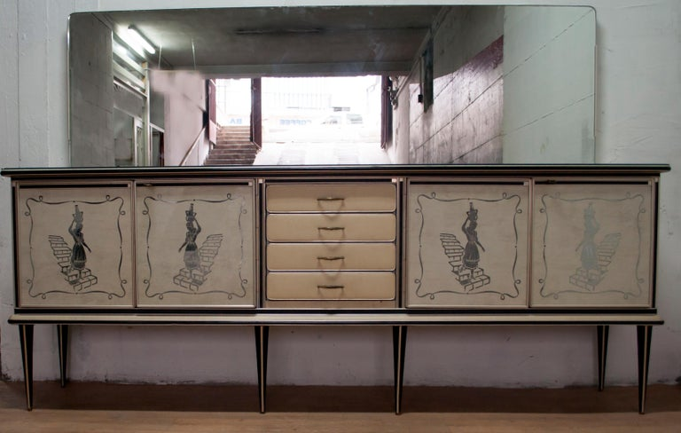 Rare and highly collectable sideboard designed in Italy by Umberto Mascagni of Bologna. Cabinet sideboard with four doors and four drawers from the 1950s was realized with back-stained glass doors, four doors with a woman walking down the stairs.