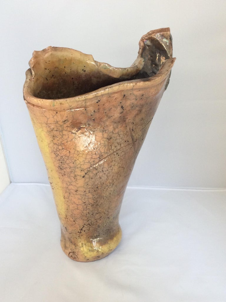 Large irregular shaped stoneware sculpted vase stamped A.R., from Vallauris, Circa 1970s. Truly stunning piece that will look great in any room. Look closely, there are gold and silver tones which are seen mostly in Japanese sculptures. There the