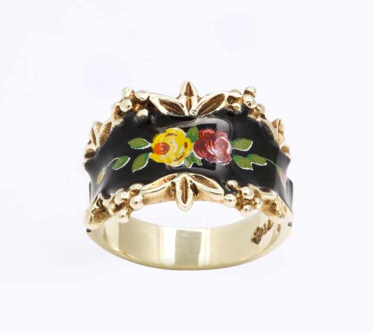 A romantic spray of roses and buds painted with enamel speaks to you on its 14 karat gold band.. The border of the enamel face is engraved with repousse, raised flowers and leaves.  The ring surprised me as I thought it was Victorian when I viewed