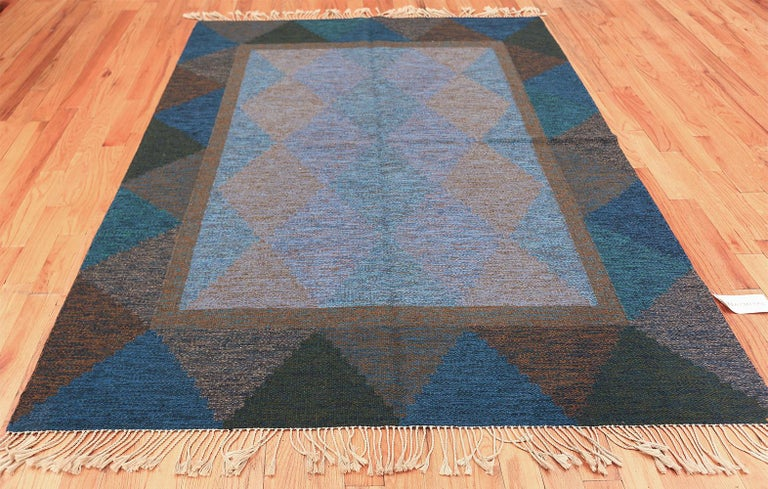 Mid Century Vintage Scandinavian Swedish Kilim Rug, Country of Origin / Rug Type: Scandinavian Rugs, Circa Date: 1950's – Size: 5 ft 8 in x 7 ft 10 in (1.73 m x 2.39 m)  Appearing like a stained glass window, this striking mid-century Swedish