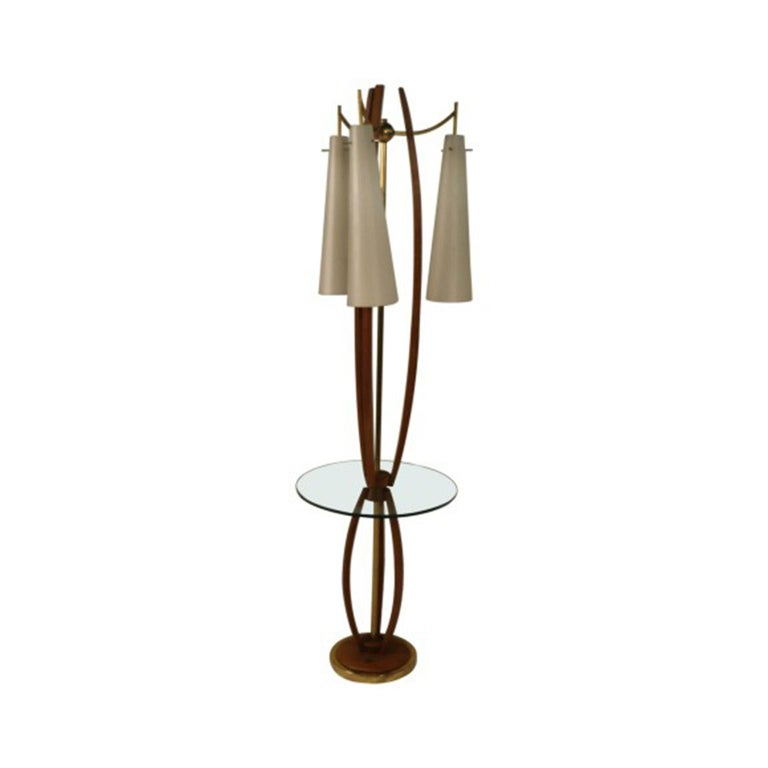 Magnificent Mid-Century Modern Italian style walnut and brass table lamp from 1950s and 1960s. Influenced by Scandinavian minimalism, MCM exquisite craftsmanship with clean sculptural lines, organic made from a mix of natural man-made materials.