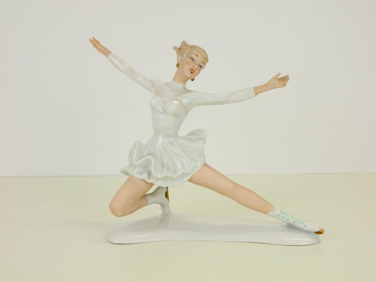 Very delicate hand painted porcelain figurine depicting the famous female figure skater from the former midcentury era Sonja Henie.  This figurine is made in German of high quality porcelain with very fine hand painted soft tones and fine golden