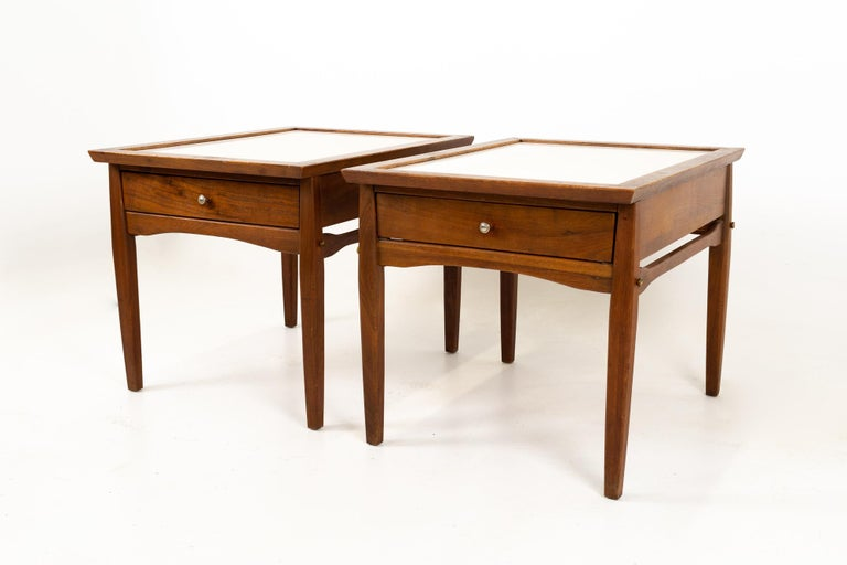 Midcentury walnut and white laminate side end tables, pair These tables are 22 wide x 29 deep x 21.5 inches high  All pieces of furniture can be had in what we call restored vintage condition. That means the piece is restored upon purchase so