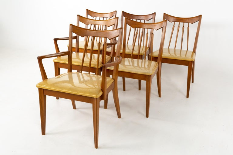 Mid century walnut dining chairs - set of 6 These chairs are 24 wide x 22.25 deep x 33 inches high, with a seat height of 17.75 and arm height of 25.25 inches   All pieces of furniture can be had in what we call restored vintage condition. That