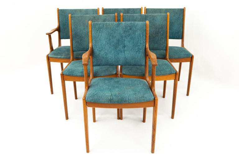Mid Century teak dining chairs, set of 6  Each chair measures: 21.5 wide x 20 deep x 35 high with a seat height of 18 inches  This set is available in what we call restored vintage condition. Upon purchase it is thoroughly cleaned and minor repairs