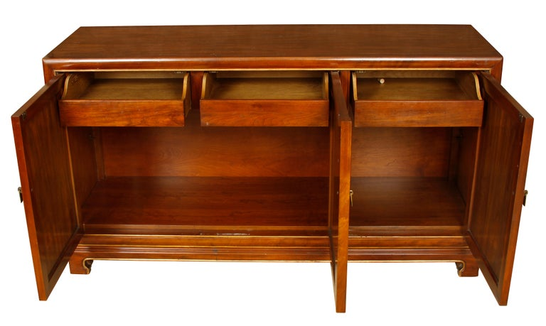 Mid-Century wood credenza with Gilt detail. Three drawers and ample storage interior