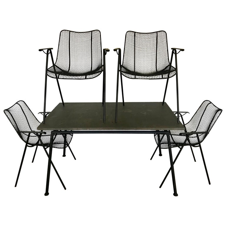 Midcentury Woodard Slate Top Patio Table with Four Wrought Iron Chairs, 1950s For Sale