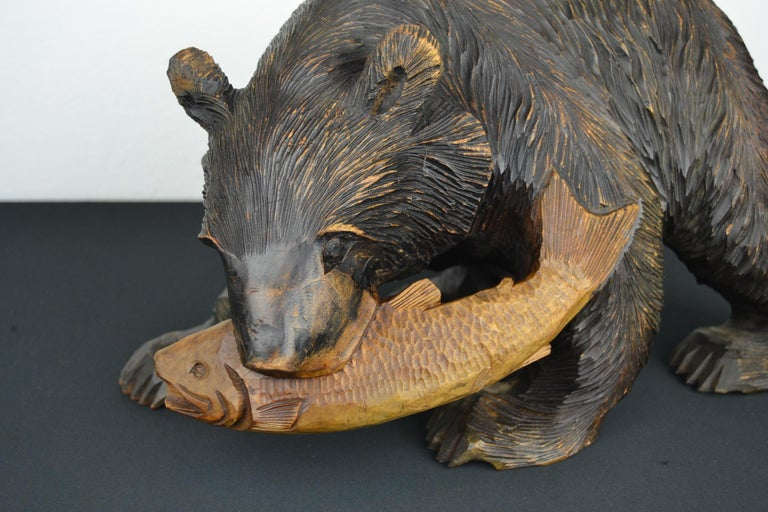 Black Forest Mid-Century Wooden Bear with Fish Sculpture For Sale