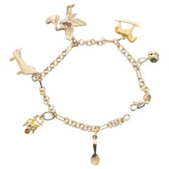 Mid-Century Yellow Gold Baby Themed Link Charm Bracelet