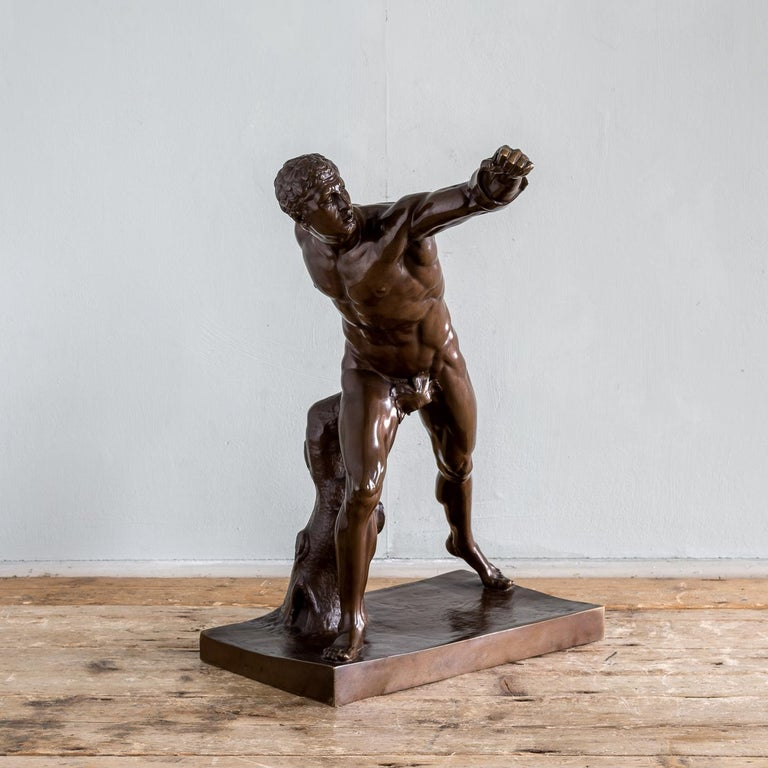 A French bronze figure of the Borghese Gladiator, mid-19th century, cast by Ferdinand Barbedienne, after the antique.  Base dimensions: 34.5cm x 20cm.