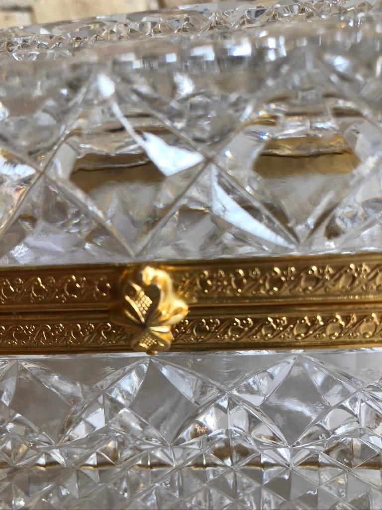 Mid-20th century Italian cut crystal and gadrooned ormolu hinged dresser box raised on ormolu paw feet.