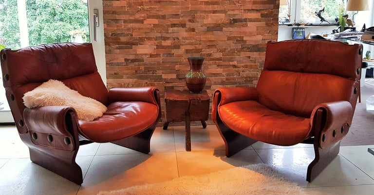 Pair of first series Leather 'Canada' chairs by Osvaldo Borsani for Tecno (see label). Frame stable in perfect condition. Leather with signs of wear. Upholstery in good condition.  Designed in 1965, Model P110. Italy  Teak wood veneered plywood,