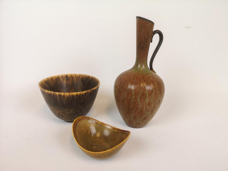 Three wonderful pieces made in Sweden during the 1950s at Rörstrand factory and designed by Gunnar Nylund.  The objects have a wonderful form and glaze.   Good condition.   Measures: Vases H 23, D 10, bowl H 9 cm, D 12 cm.