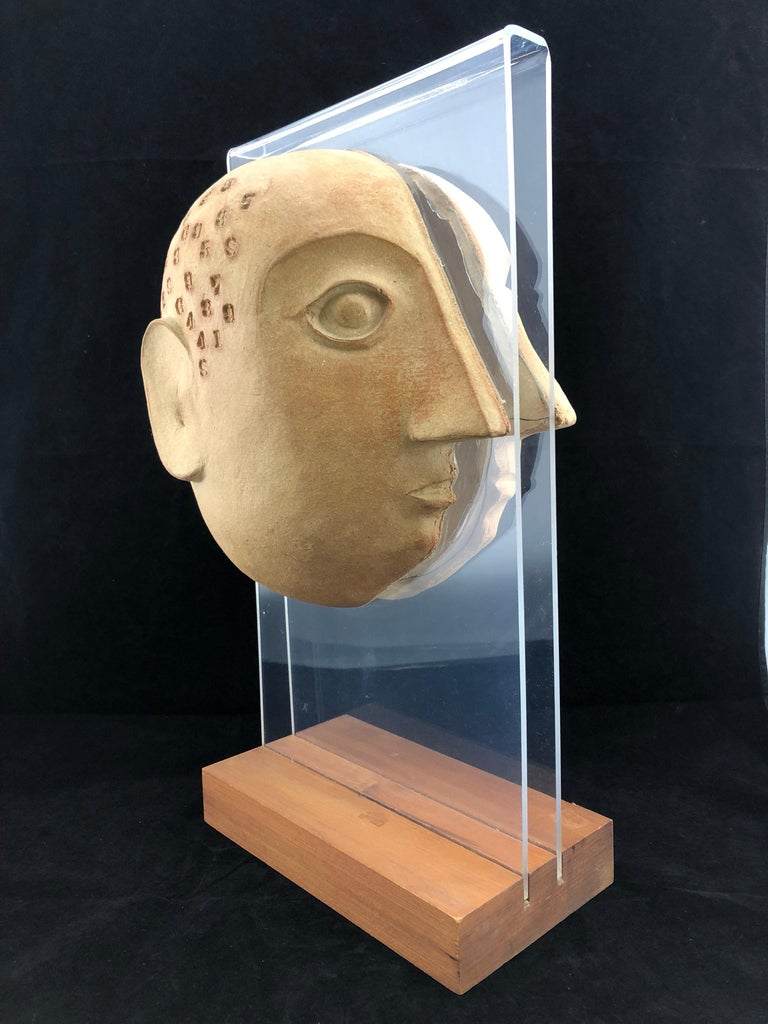 Midcentury acrylic and ceramic head sculpture by David Gil for Bennington. No known issues that would detract from value or aesthetics. Ready for use.