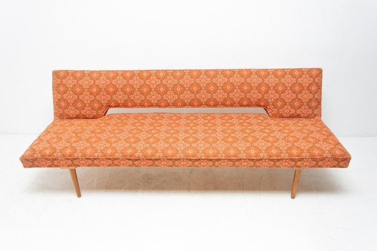 Midcentury adjustable sofa-bench designed by the Czech famous designer Miroslav Navrátil in the 1960s. Made in Czechoslovakia. It features very attractive and simple design. Material: fabric, beechwood. It´s a typical example of Czechoslovak design