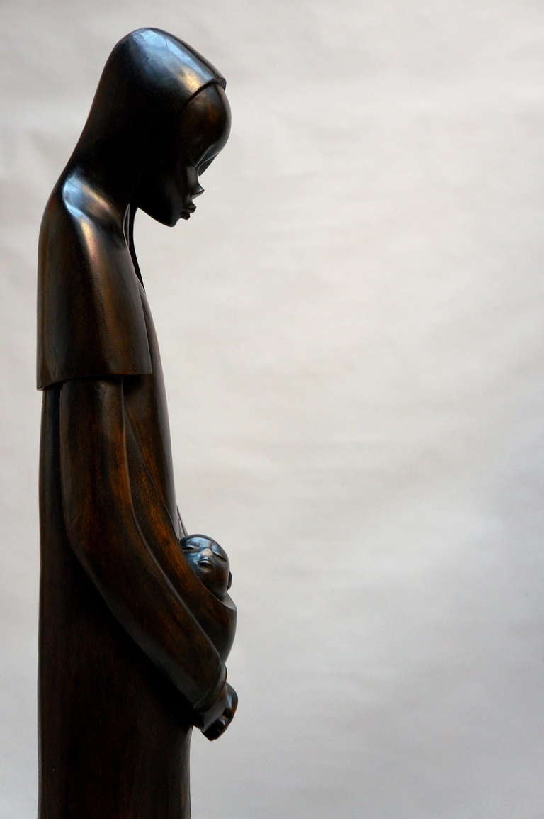 Midcentury African wood sculpture wonderfully hand carved depiction of the Virgin Mary with Child, with great detailing and beautiful face signed by Par Makengo-B. Congo, 1930s-1950s. Measures: Height 138 cm. Diameter 25 cm.