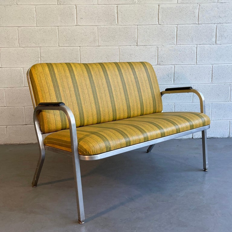 Midcentury, machine-age loveseat sofa by GoodForm, The General Fireproofing Co. features a streamlined aluminum frame with striped vinyl upholstery and painted wood armrests.