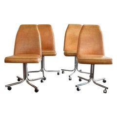 Midcentury and Chrome Rolling Brown Bucket Chairs Set of Four