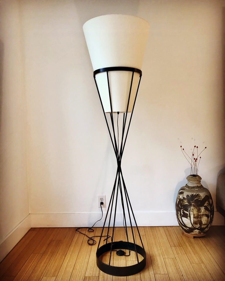 Made of powder coated steel with new cone shade and wiring. The shade sits loosely inside the top frame.  It has a nice scale for any interior.