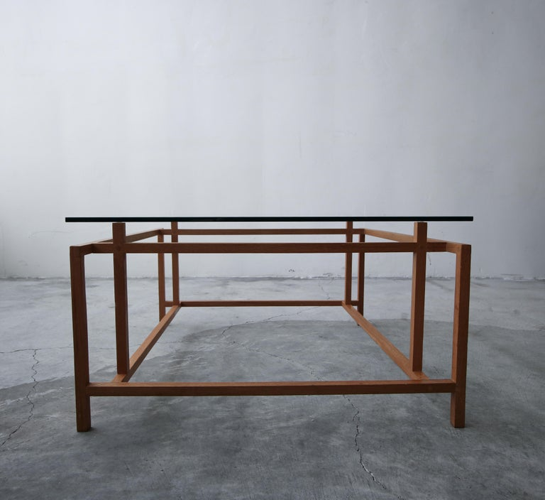 Midcentury Danish teak coffee table by Henning Norgaard for Komfort. A very simple yet beautiful table with a very architectural appearance.  The table is in excellent condition overall. Glass has minor scratches from age and use but overall there