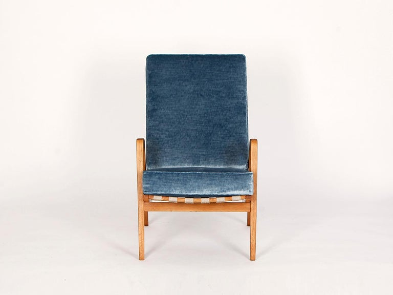 This lounge chair was made in the former Czechoslovakia in the 1950s. The hemp straps have been renewed and the wooden parts repainted. The cushions have a coconut fiber core wrapped in sheep wool. Very quality English velvet upholstery from Colefax