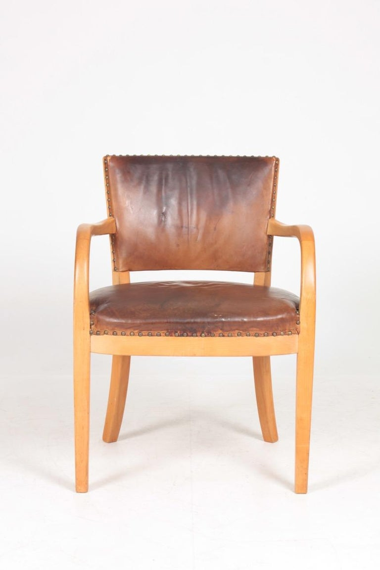 Armchair in patinated leather designed and made by Fritz Hansen in 1940s. Original condition.