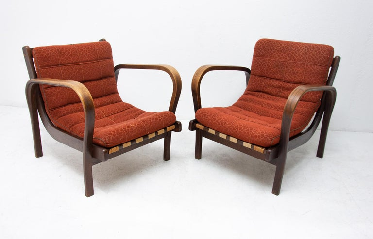 A pair of midcentury armchairs designed by Kropacek and Kozelka, manufactured in the former Czechoslovakia for Interior Praha. These armchairs received a silver medal at the 1946 Milan Triennale. The armchairs are in very good condition, feature a