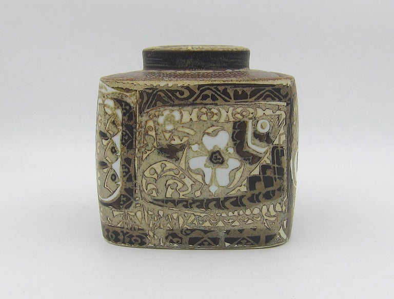 A Scandinavian Modern tobacco jar / humidor designed by Nils Thorsson for Royal Copenhagen of Denmark in the 1960s. Thorsson's covered jar is from his BACA series in neutral shades of brown, beige, and white featuring abstracted bird and flower