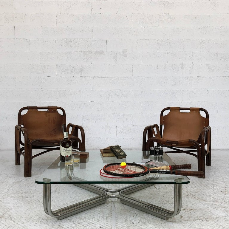 Pair of two lounge armchairs attributed to Tito Angoli and produced by the Italian manufacturer Bonacina in 1963. Perfect condition for a perfect living room.