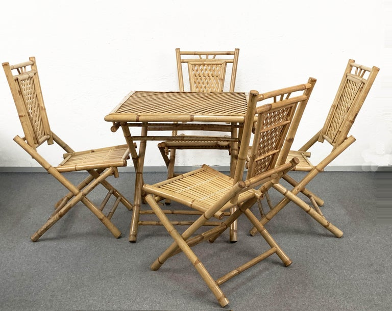 Beautiful midcentury set, made of bamboo and rattan foldable table and four chairs. It is an Italian production of 1960s and the state of conservation is just excellent.  The item is perfect both for inside and outside, and the foldable table