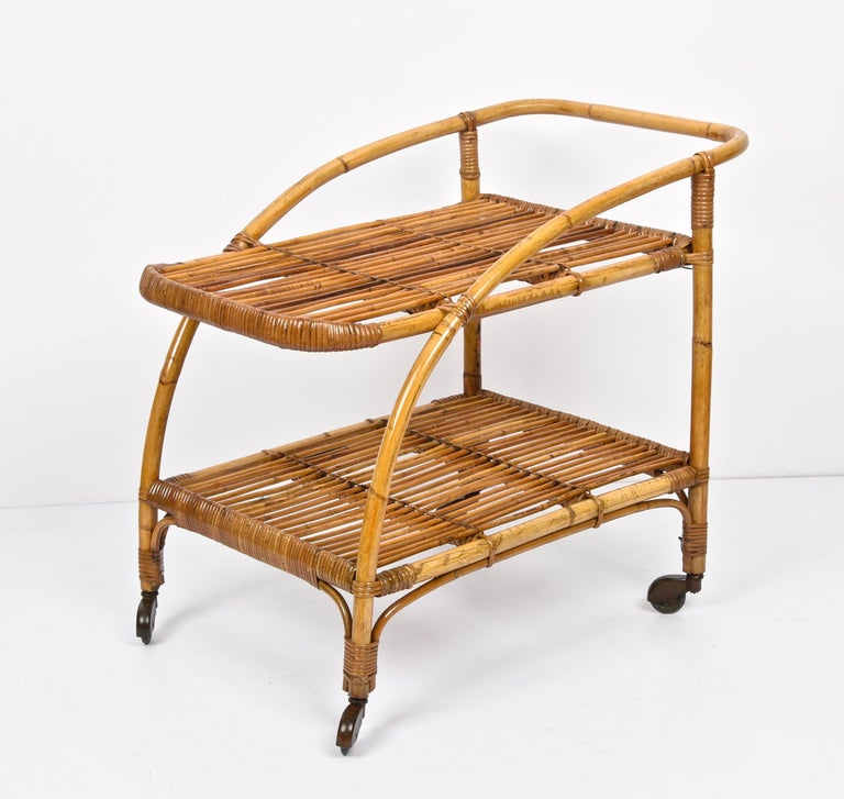 Amazing midcentury in bamboo and rattan with wheels. This unique piece was produced in Italy during the 1950s.  This piece is in fantastic vintage condition and you are going to love the connection between straight and curved lines  A fabulous