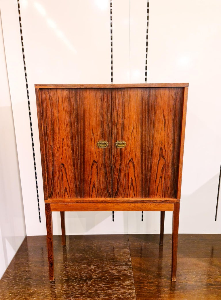 This wonderful bar cabinet in rosewood was designed by Henning Korch. It was produced in Denmark at Silkeborgs Funriture Factory.