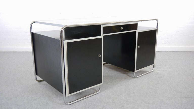 Vintage Bauhaus style tubular steel desk, Germany 1940s-1950s. Straight traduced design with one drawer and two doors on each side with drawers inside. Three keys available with the desk. Formica surfaces are quite good. Silvery edges are repainted.