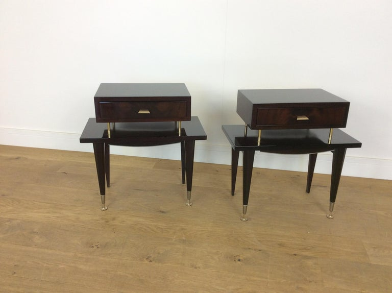 Midcentury nightstands. A pair of midcentury bedside cabinets. Very stylish bedside tables in a dark mahogany by Ameublement NF Meuble. Measures: 56 cm H, 55 cm W, 30 cm D. French, circa 1960.