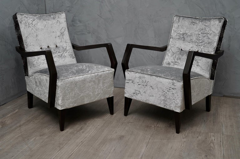 Very elegant appearance due the use of not common fabric, coming from particular Italian silk factory, this gentle upholstery gives these armchairs a very luxurious appearance.  All covered with two types of combined velvet. One light gray crumpled