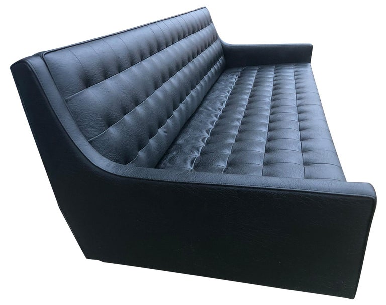 Midcentury Black Faux Leather Vinyl Tufted Long low Sofa by Patrician In Good Condition For Sale In BROOKLYN, NY
